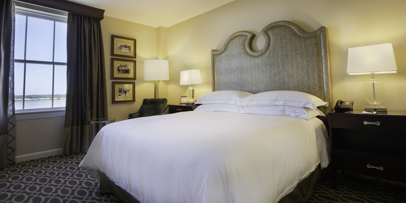 Hilton Baton Rouge Capitol Center-Suite Bedroom, Right-side View<br/>Image from Leonardo