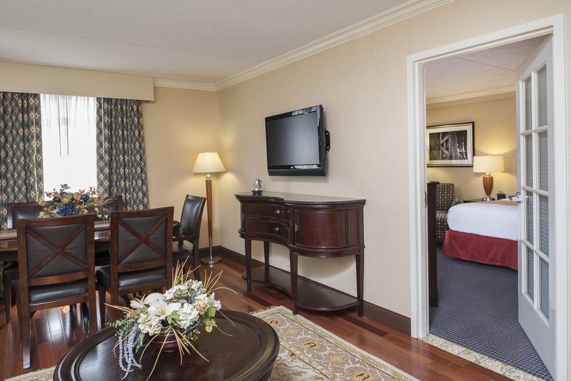 DoubleTree by Hilton Grand Rapids Airport-King Bed Junior Suite Living Area and Bedroom<br/>Image from Leonardo