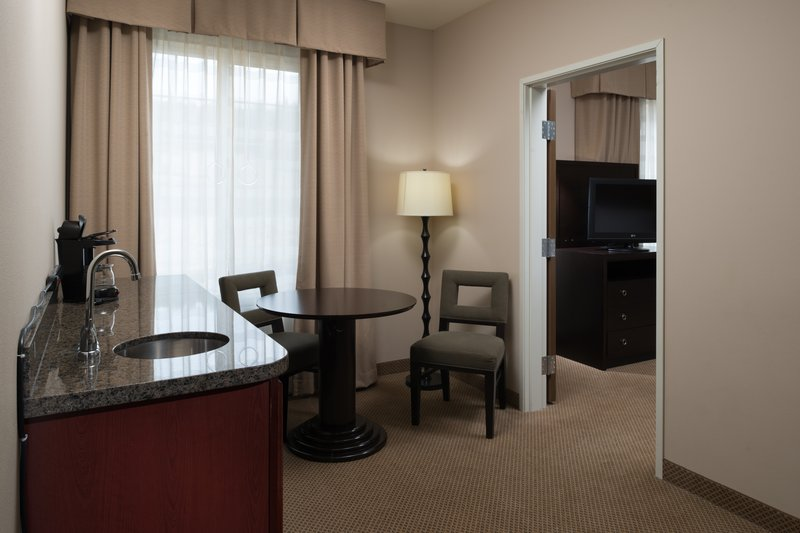 Holiday Inn Express Hotel & Suites North Sequim-ADA Accessible two room suite with a king bed and sitting room<br/>Image from Leonardo
