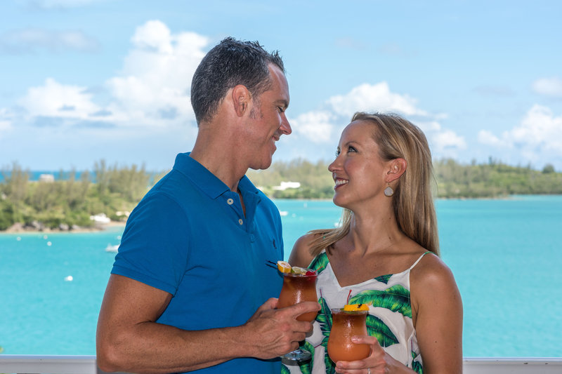 Cambridge Beaches Resort & Spa-Couple Balcony Drinks<br/>Image from Leonardo