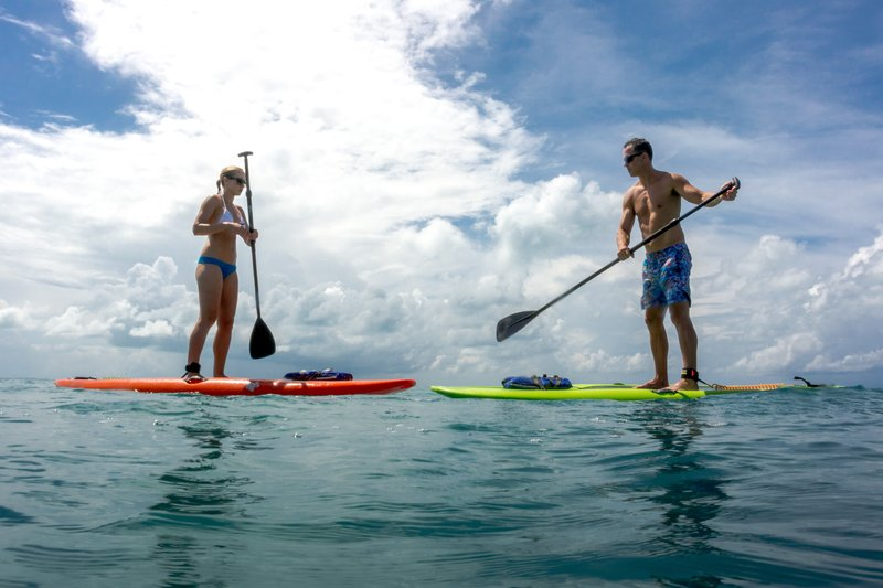 Grotto Bay Resort-Paddle Boarding Couple<br/>Image from Leonardo
