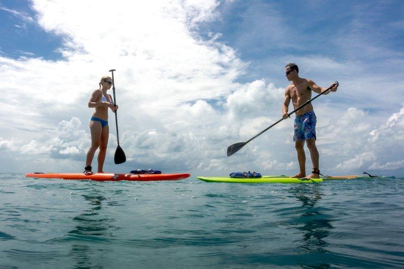 Cambridge Beaches Resort & Spa-Paddle Boarding Couple<br/>Image from Leonardo