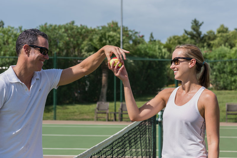 Grotto Bay Resort-Tennis Couple Teasing<br/>Image from Leonardo