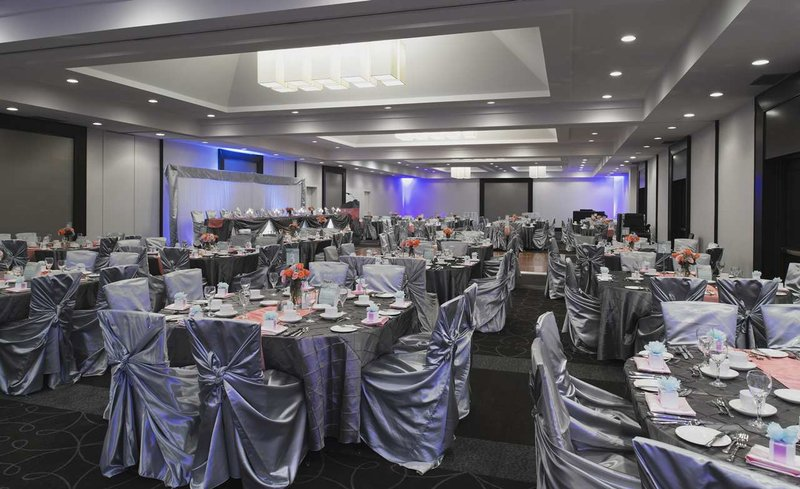 Hilton Winnipeg Airport Suites-Ballroom Wedding Silver Chairs<br/>Image from Leonardo