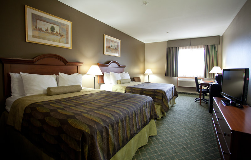 Best Western Plus Tulsa Inn  Suites-Guest Room with Two Queen Beds<br/>Image from Leonardo