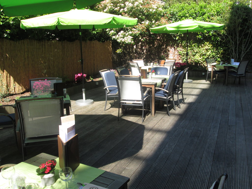 Holiday Inn Brussels - Schuman-You can dine in the leafy courtyard on warm days<br/>Image from Leonardo