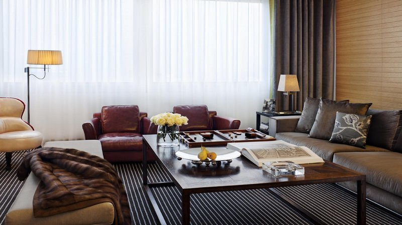 InterContinental Geneve-Living Room with its leather armchair in a Panoramic Suite<br/>Image from Leonardo
