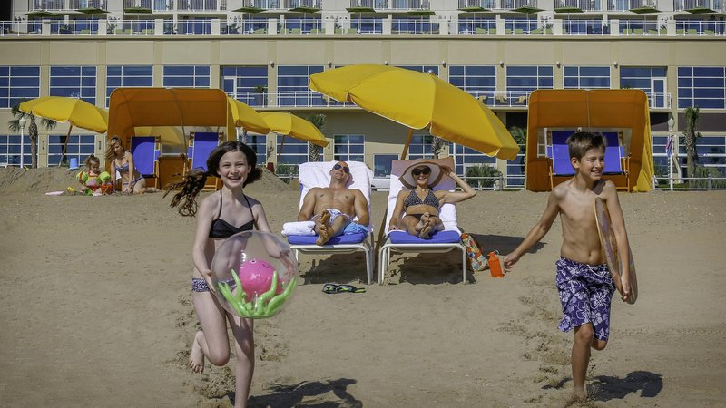 Hilton Garden Inn Virginia Beach Oceanfront-Family on Beach<br/>Image from Leonardo