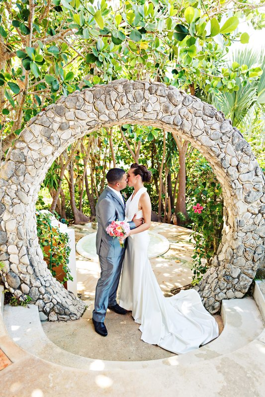 Grotto Bay Resort-Grotto Bay Wedding Moongate Kiss<br/>Image from Leonardo