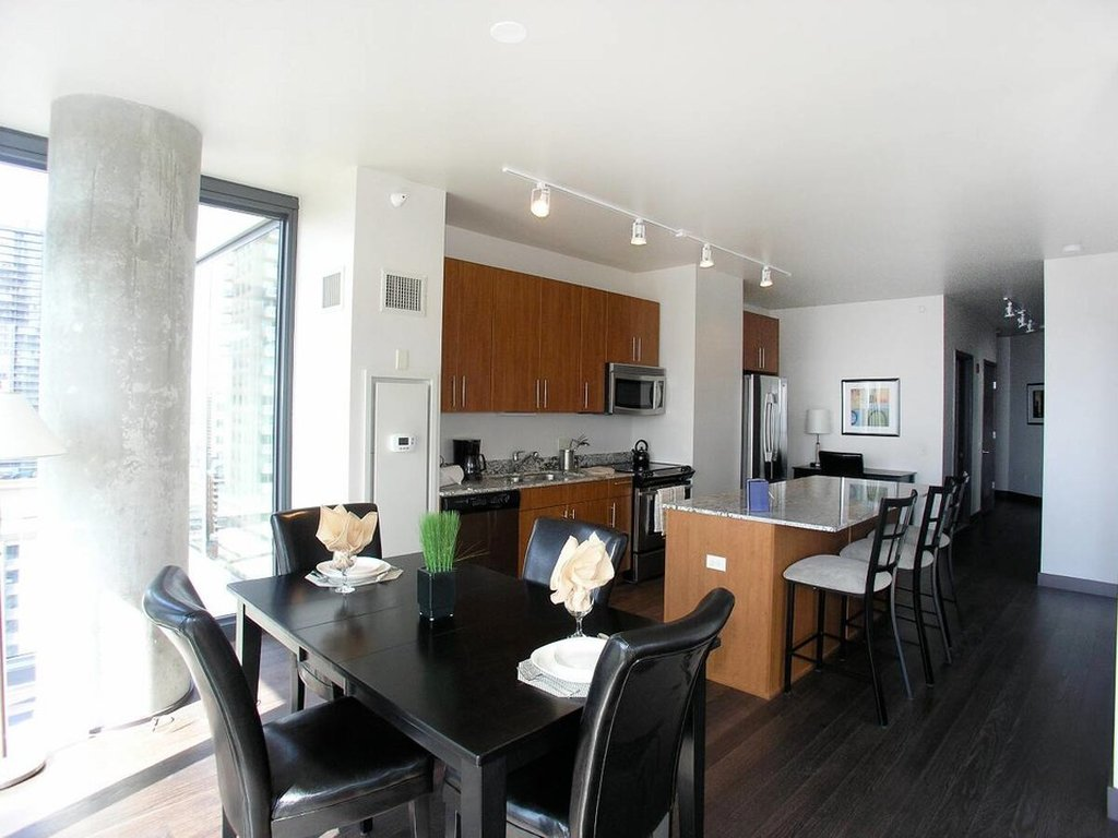 State And Grand Apartments-Kitchen And Dining Table<br/>Image from Leonardo