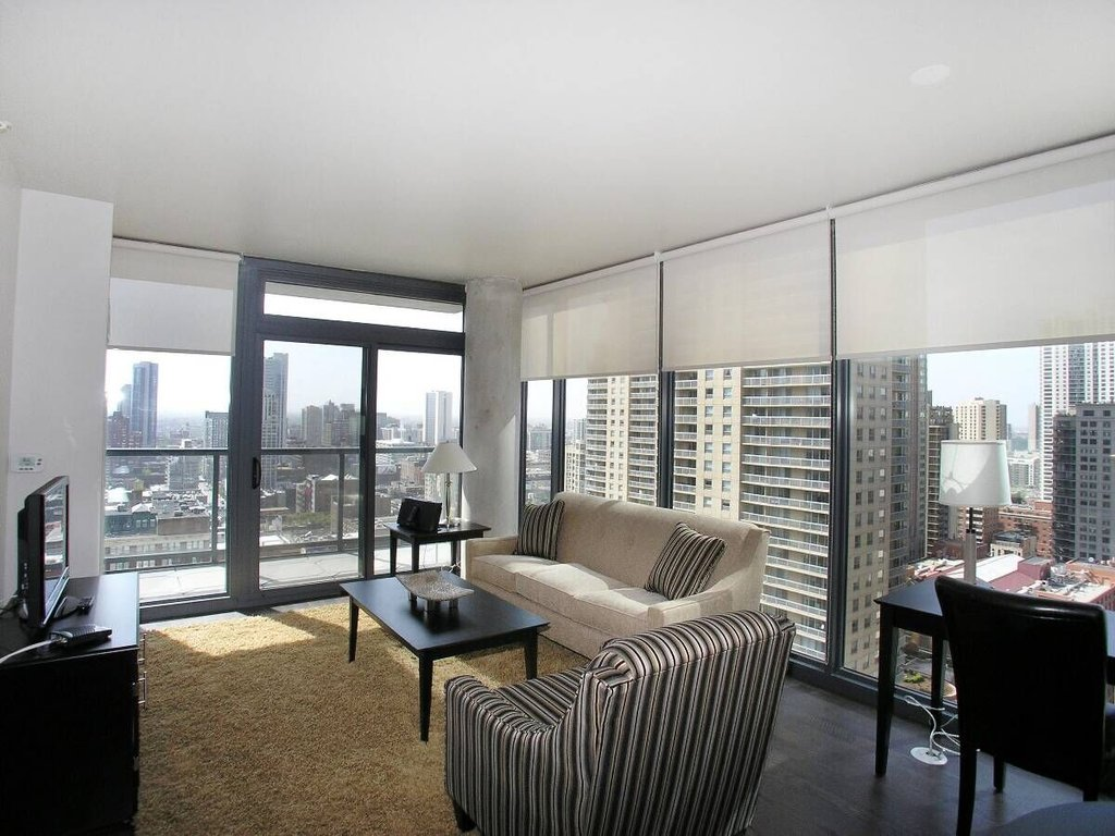 State And Grand Apartments-Living Area<br/>Image from Leonardo