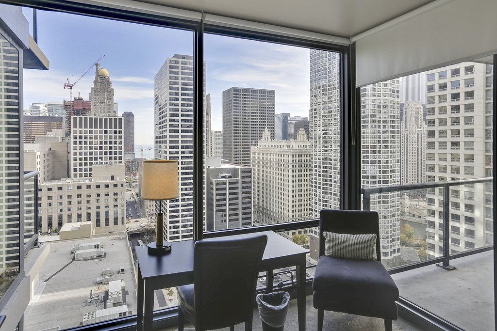 State And Grand Apartments-Floor Plan Sitting Are<br/>Image from Leonardo