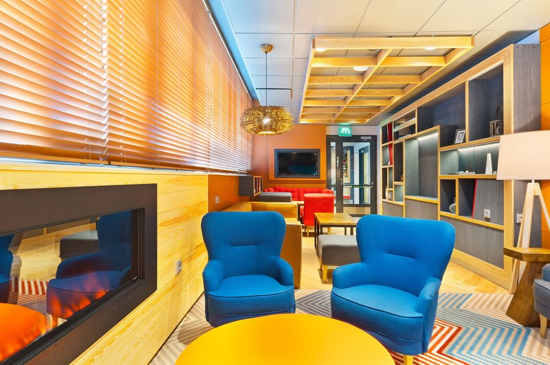 Holiday Inn Tampere - Central Station-Sit down at our Open Lobby and enjoy the fireplace<br/>Image from Leonardo