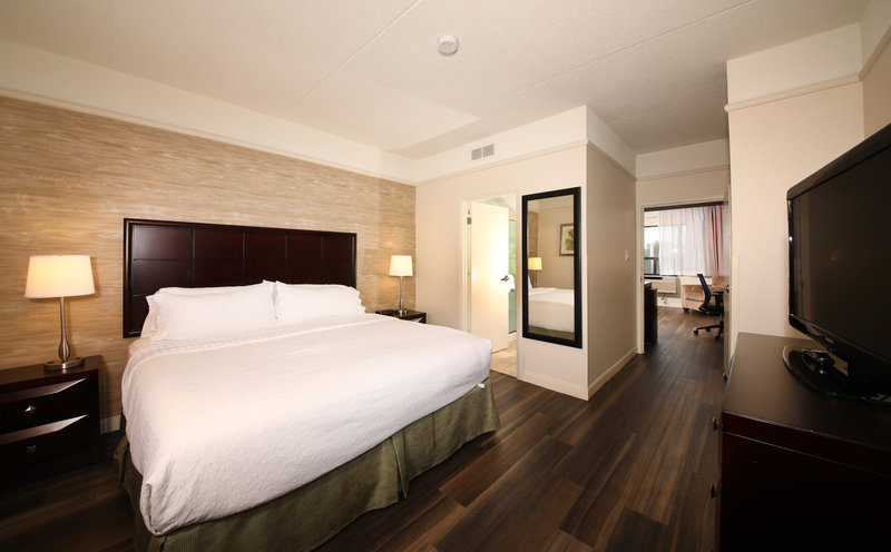 Holiday Inn Hotel & Suites Windsor (Ambassador Bridge)-The bedroom in our 2-Room Suite<br/>Image from Leonardo
