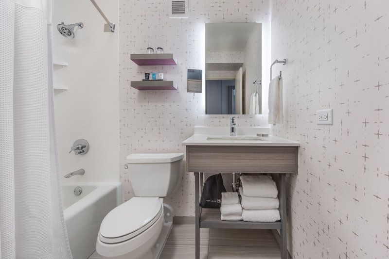 Crowne Plaza Downtown Denver-Bright and spacious bathroom with shaving & make up mirror<br/>Image from Leonardo