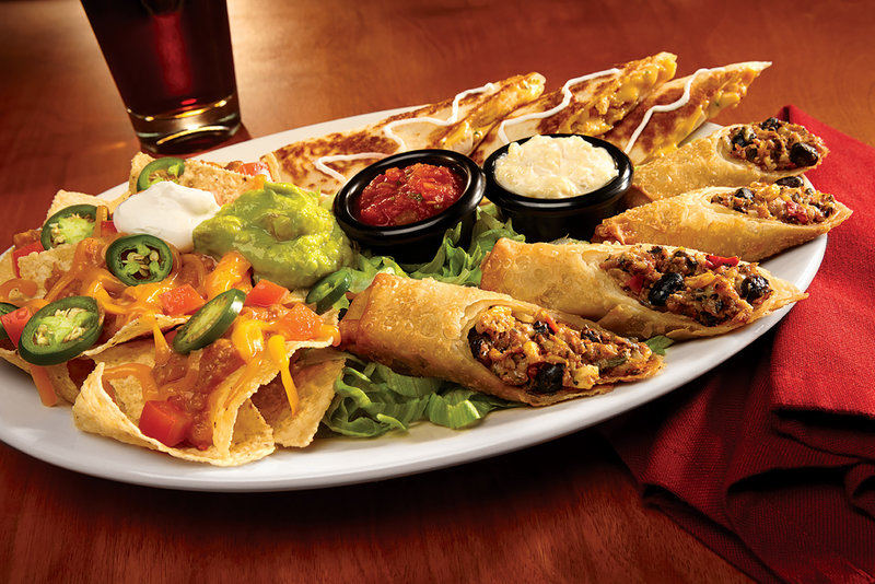 Holiday Inn Hotel & Suites Des Moines-Northwest-Country Clare Sampler combines the best of Bennigan's appetizers.<br/>Image from Leonardo