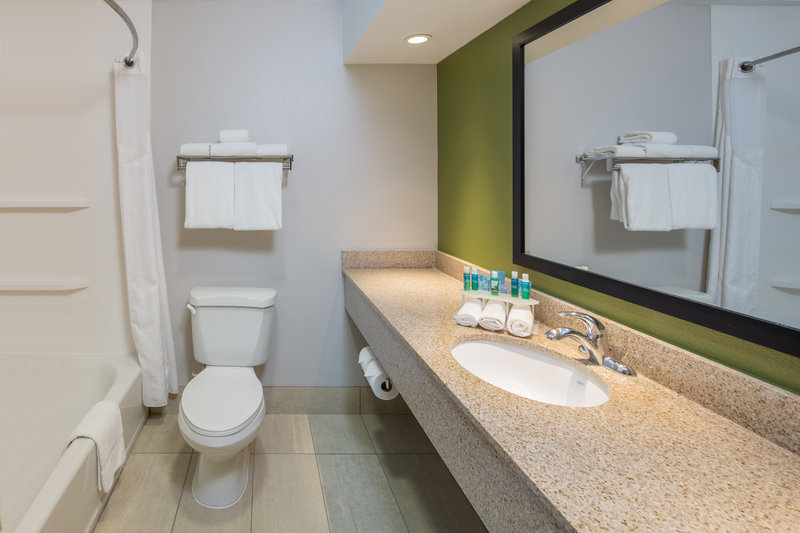 Holiday Inn Express Cedar Rapids (Collins Rd)-Spacious and Clean Guest Bathroom<br/>Image from Leonardo