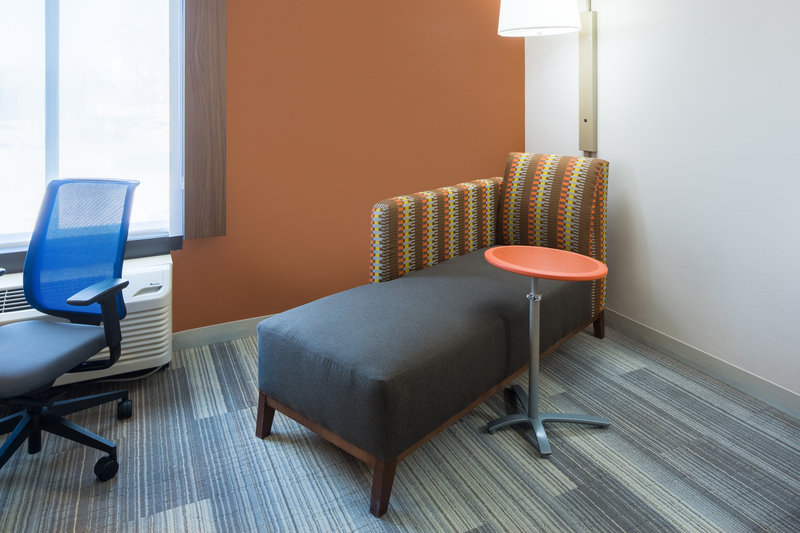 Holiday Inn Express Cedar Rapids (Collins Rd)-Comfortable Chaise Lounge with adjustable table<br/>Image from Leonardo