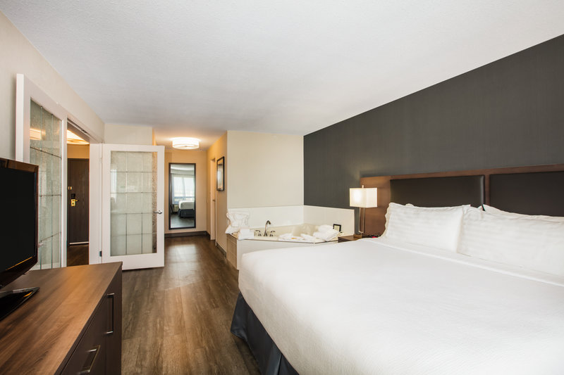 Holiday Inn Hotel & Suites Grande Prairie-Conference Ctr-Feel like Royalty When You Stay In A Spacious King Bed Suite<br/>Image from Leonardo