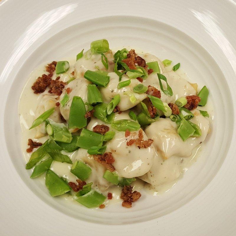 Holiday Inn Saskatoon Downtown-Cabonara Perogies with  Garlic cream, chopped snap peas, bacon.<br/>Image from Leonardo
