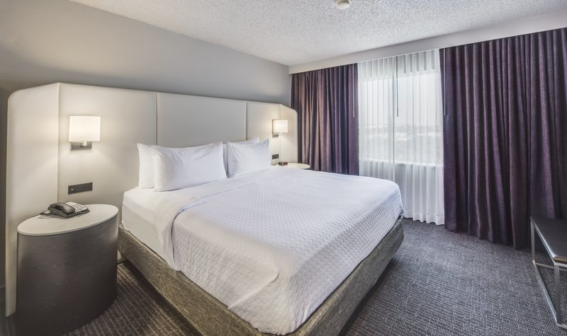 Crowne Plaza Suites Arlington - Ballpark - Stadium-The spacious bedroom of our WorkLife Suites!<br/>Image from Leonardo