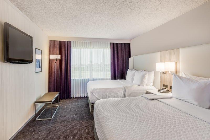 Crowne Plaza Suites Arlington - Ballpark - Stadium-Two Queen WorkLife Suite Bedroom<br/>Image from Leonardo