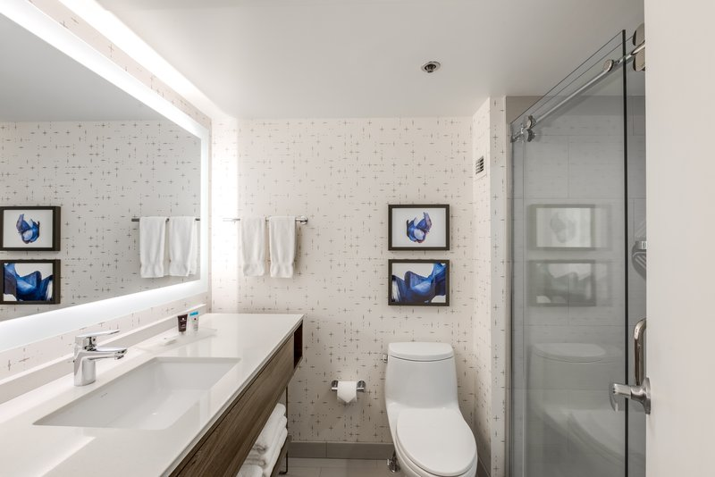 Crowne Plaza Suites Arlington - Ballpark - Stadium-Completely Transformed WorkLife Bathrooms are Modern and Bright<br/>Image from Leonardo