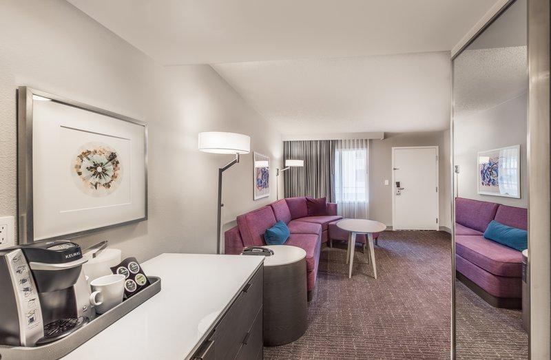 Crowne Plaza Suites Arlington - Ballpark - Stadium-Transformed WorkLife Suite Living Room and Welcome Station<br/>Image from Leonardo