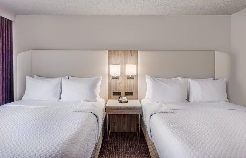 Crowne Plaza Suites Arlington - Ballpark - Stadium-Completely Transformed Two Queen WorkLife Suite Bedroom<br/>Image from Leonardo