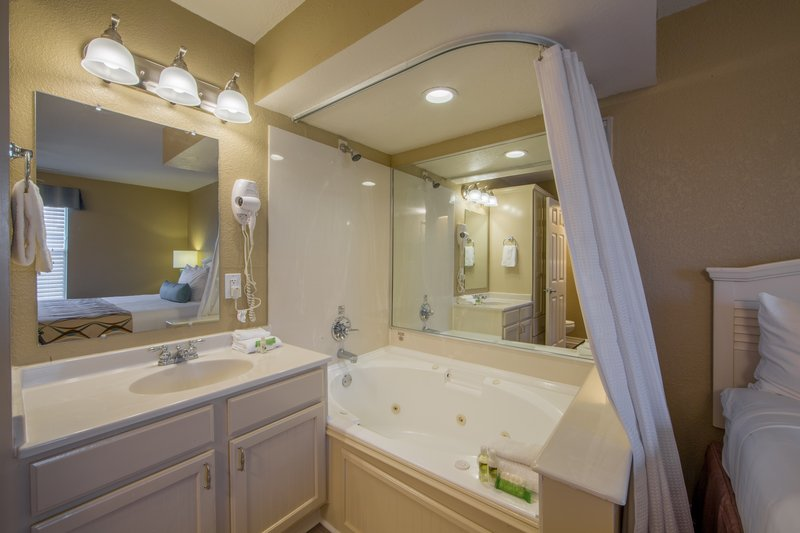 Holiday Inn Club Vacations Galveston Beach Resort-Bathroom sink and jacuzzi tub<br/>Image from Leonardo