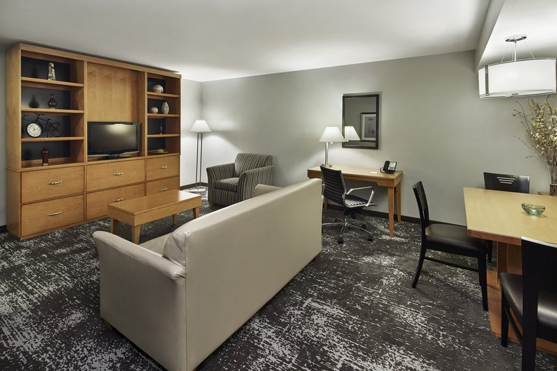 Holiday Inn Hotel & Suites Alexandria Old Town-Comfy sleeper sofa, separate living room and a mini kitchenette.<br/>Image from Leonardo