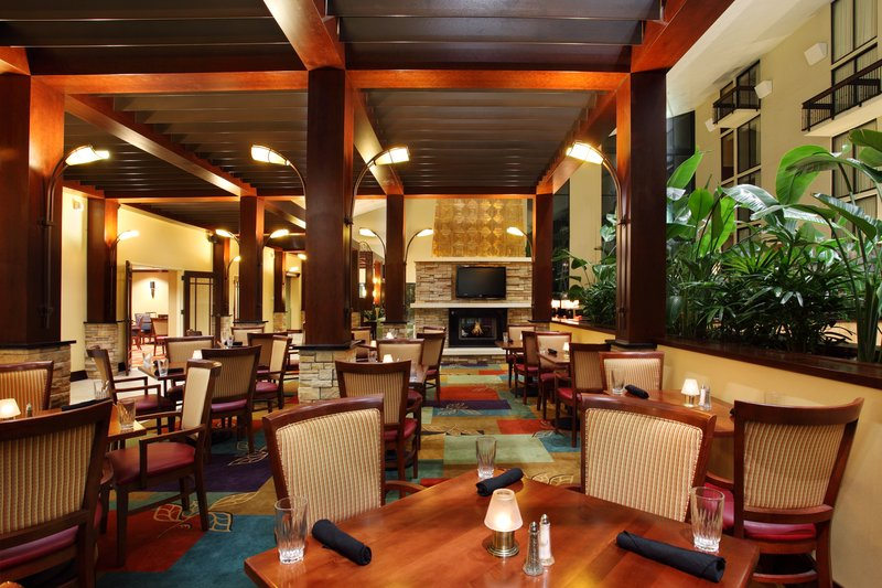 Holiday Inn Asheville - Biltmore West-Atrium dining next to the lobby fireplace.<br/>Image from Leonardo