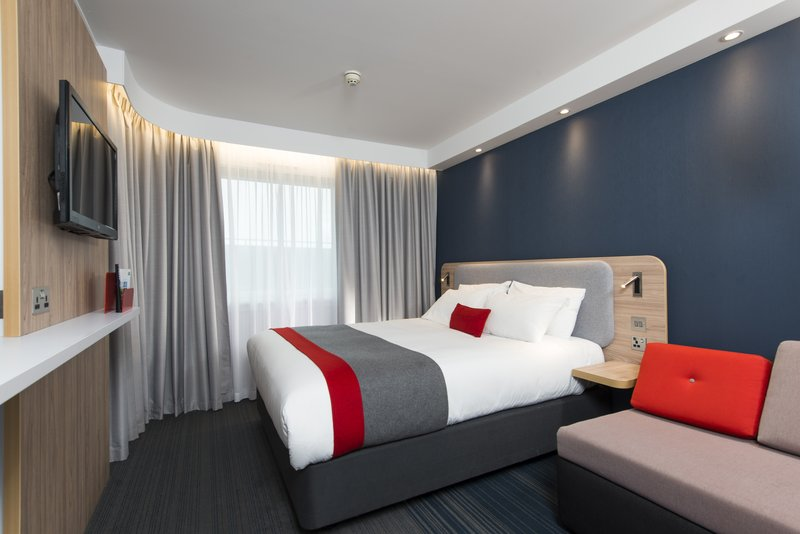 Holiday Inn Express Milton Keynes-Watch your favourite shows on the wall-mounted TV with Freeview<br/>Image from Leonardo