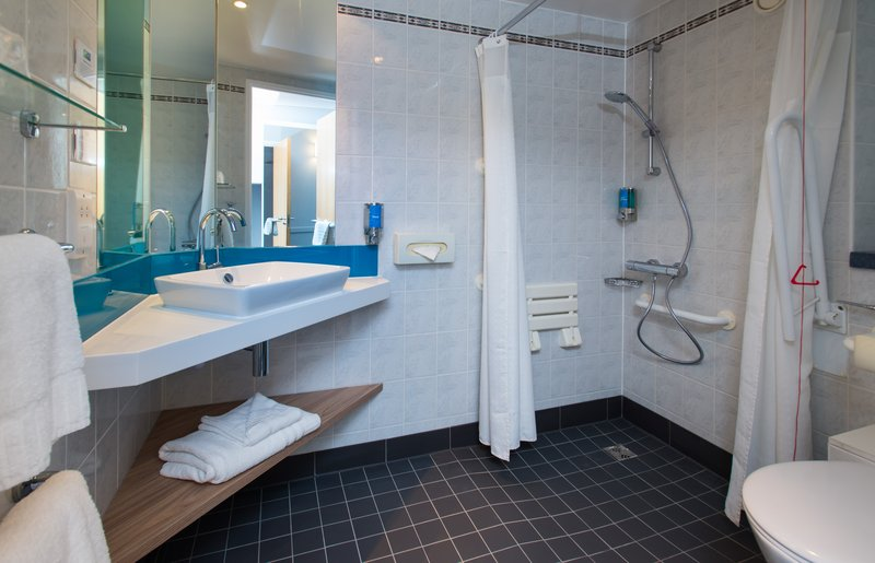 Holiday Inn Express Milton Keynes-Our accessible en-suites are well-equipped for wheelchair users<br/>Image from Leonardo