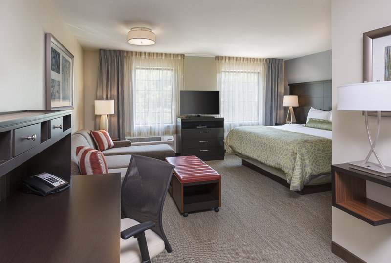 Staybridge Suites Canton-Our studio suite features a desk, flat-screen television and more.<br/>Image from Leonardo