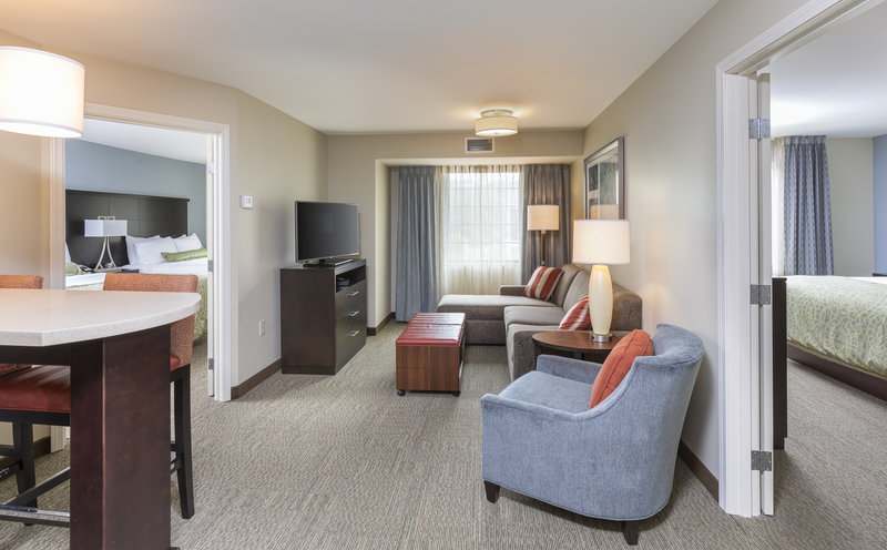 Staybridge Suites Canton-Living room view of our two bedroom suites with kitchen<br/>Image from Leonardo
