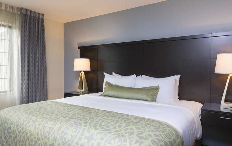 Staybridge Suites Canton-Guest room bed with crisp linens and comfortable pillows<br/>Image from Leonardo