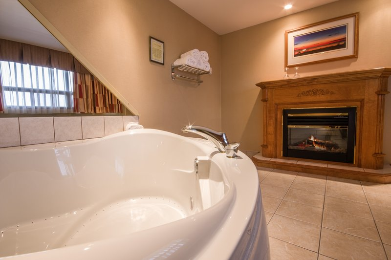 Holiday Inn St. John's Conference Centre-Inviting electric fireplace & jacuzzi tub<br/>Image from Leonardo