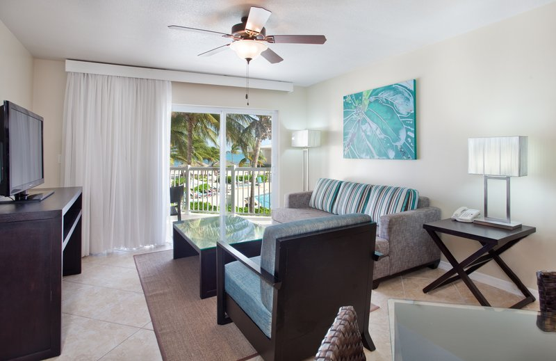 Holiday Inn Resort Grand Cayman-One Bedroom King Suite with pool view living area<br/>Image from Leonardo