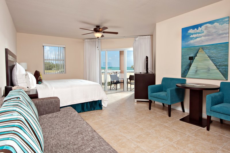 Holiday Inn Resort Grand Cayman-Standard Guest Room- One Queen Bed and Couch<br/>Image from Leonardo