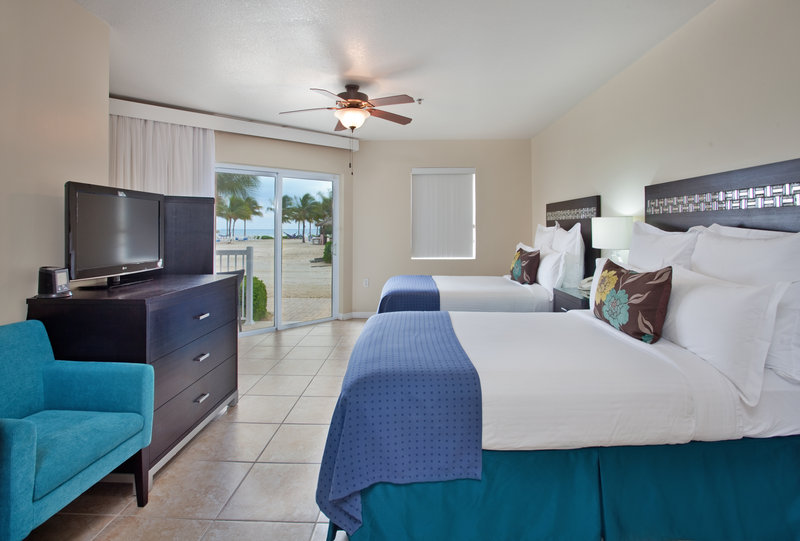 Holiday Inn Resort Grand Cayman-Standard Guest Room- Two Queen Beds with ocean view<br/>Image from Leonardo
