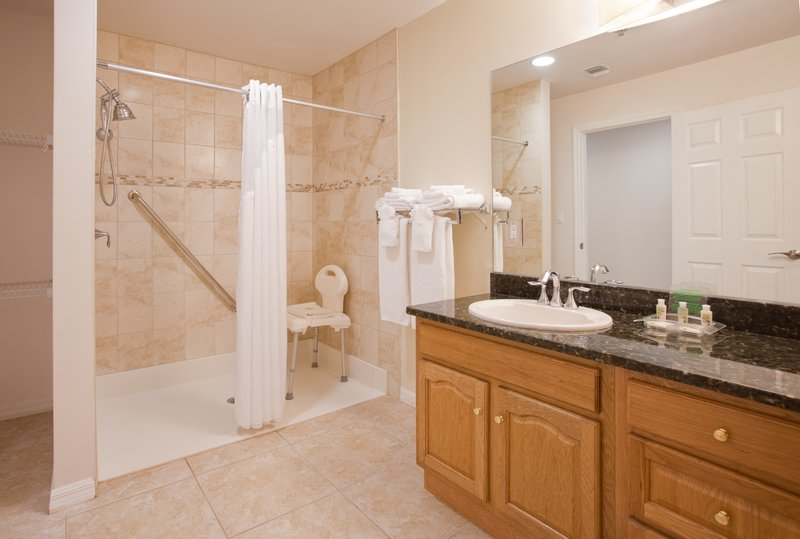 Holiday Inn Resort Grand Cayman-ADA/Handicapped accessible Guest Bathroom with roll-in shower<br/>Image from Leonardo