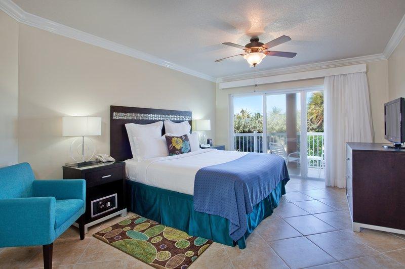 Holiday Inn Resort Grand Cayman-Two Bedroom, Two Bath Grand Villa Bedroom<br/>Image from Leonardo