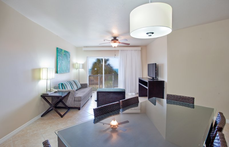 Holiday Inn Resort Grand Cayman-One Bedroom King Suite- living area, family vacations, 900 sq ft<br/>Image from Leonardo