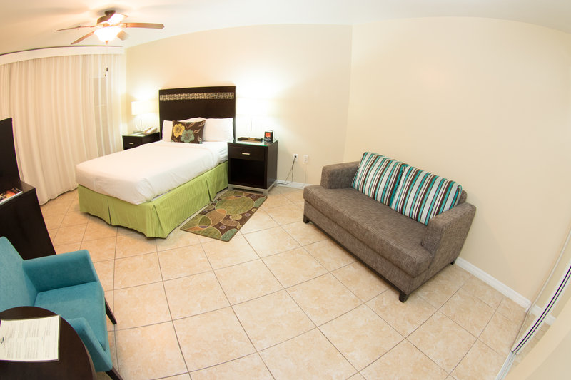 Holiday Inn Resort Grand Cayman-Standard Guest Room- One King Bed and Couch<br/>Image from Leonardo