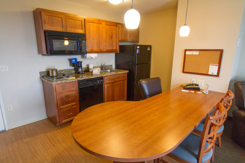 Candlewood Suites Santa Maria-One bedroom suite with well appointed kitchen and seating area<br/>Image from Leonardo
