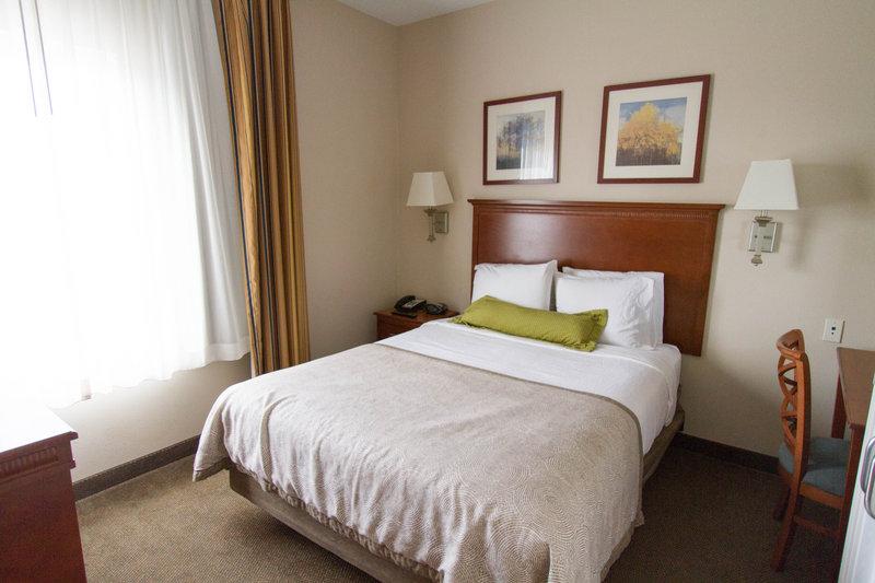 Candlewood Suites Santa Maria-Suite bedroom with work desk, TV, movie channels & free Internet<br/>Image from Leonardo