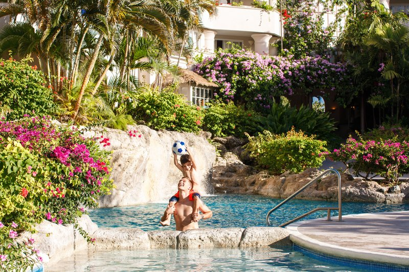 Bougainvillea Barbados-Bougainvillea Barbados - Father and Son by Pool<br/>Image from Leonardo