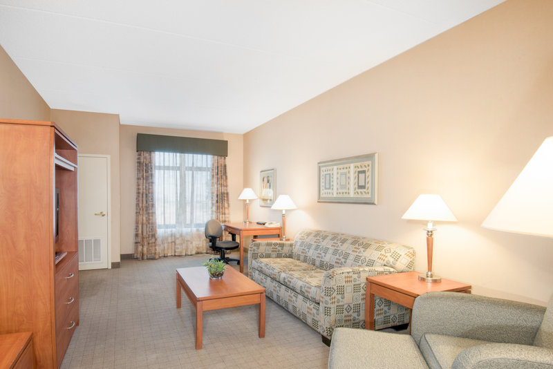 Holiday Inn Express Phoenix-I-10 West/Goodyear-One Bedroom King Suite Living Area<br/>Image from Leonardo