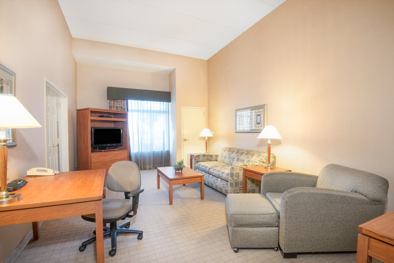 Holiday Inn Express Phoenix-I-10 West/Goodyear-ADA/Handicapped accessible One Bedroom King Suite Living Area<br/>Image from Leonardo
